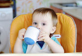 Baby drink from baby cup — Stock Photo