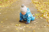 Happy baby age of 1 year creeps on path in park outdoors — Stock Photo
