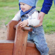 Stock Photo: Baby on teeter totter