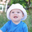 Portrait of smiling baby in white hat — Foto Stock