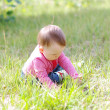 Baby playing on grass in summer — Stock Photo