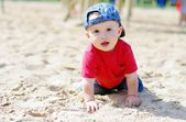 Baby boy age of 11 months creeps on playground — Stock Photo