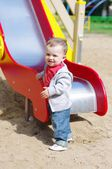 Nice baby boy age of 11 months on playground in summer — Stock Photo