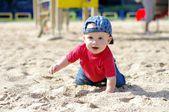Happy baby creeps on playground — Stock Photo