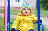 Baby age of 11 months on seesaw — Stock Photo