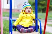 Lovely baby on seesaw — Stock Photo