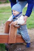 Baby on teeter totter — Stock Photo