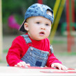 Lovely baby on playground in summertime — Stock Photo