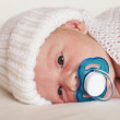 Newborn baby boy with pacifier — Stock Photo