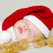 Lovely sleeping baby in a New Year's hat — Stock Photo #34874773