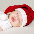 Lovely baby sleeping in a New Year's hat — Stock Photo #34874841