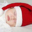 Lovely baby sleeping in santa hat — Stock Photo