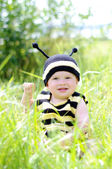 Baby in bee costume outdoors — Stock Photo