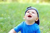Lovely baby looks up in summer — Stok fotoğraf