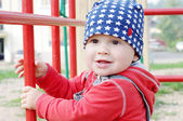 Smiling baby age of 10 months on playground — Stock Photo
