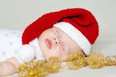 Lovely sleeping baby in a New Year's hat — Stock Photo