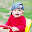 Baby age of 10 months teeters outdoors in summer — Stock Photo #34891793