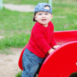 Nice baby boy age of 10 months on playground in summer — Stock Photo #34891801