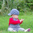 Baby sitting on grass in park — Stock Photo #34892003
