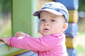 Thoughtful baby age of 10 months on playground in summer — Stock Photo