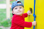 Baby age of 10 months on playground in summer — Stock Photo