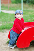 Nice baby boy age of 10 months on playground in summer — Stock Photo