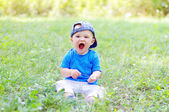 Funny baby boy is glad for summer — Stock Photo