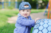 Portrait of happy baby boy age of 10 months outdoors — Stock Photo