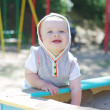 Happy baby age of 9 months plays in sandpit — Stock Photo #34960935