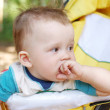 Thoughtful baby age of 9 months on buggy — Stock Photo