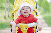 Happy smiling baby on baby buggy — Stock Photo