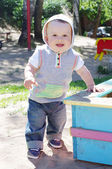 Baby age of 9 month toddles outdoors on playground — Stock Photo