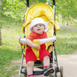 Baby age of 9 months on buggy — Stock Photo