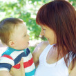 Mother and son walking in park — Stock Photo