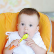 Surprised baby age of 9 months with spoon — Stock Photo