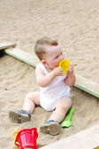 Baby plays with sand mold on playground — Stock Photo