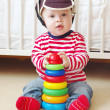 Baby plays at home in baby safety helmet — Stock Photo