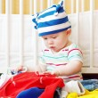Baby among clothes — Stock Photo