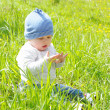 Baby sitting on grass — Stock Photo