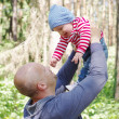 Father and son walking in forest — Stock Photo