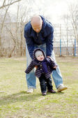 Father learns his son to go outdoors in spring — Stock Photo