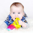 Five-months baby plays multi-colored spring — Stock Photo