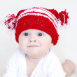 Portrait of funny baby in red knitted hat — Stock Photo