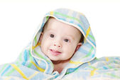 Baby covered by blue blanket on white background — Stock Photo