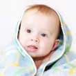 Baby covered by blue blanket — Stok fotoğraf