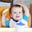 Happy baby boy with round cracknel — Stock Photo #35397953