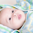 Lovely baby in blue towel — Stock fotografie