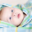 Baby in blue towel — Foto de Stock