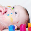 Four-months baby with multi-colored paints — Stock Photo