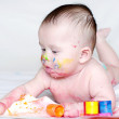 Portrait of baby with multi-colored paints — Stock Photo